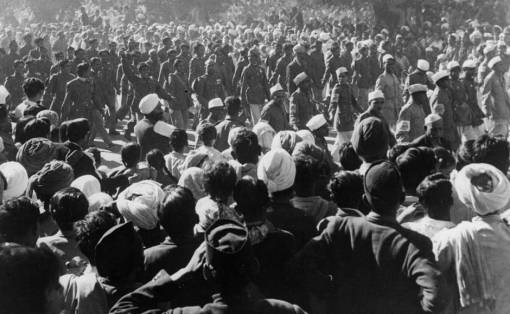 The ashes of Mahatma Gandhi are collected at his funeral, held in Delhi and attended by several thousand people on 9 February 1948. Keystone/Getty Images