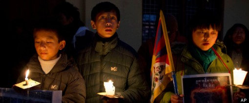 Exile Tibetans hold a candlelit vigil in solidarity with Tibetans who self-immolated