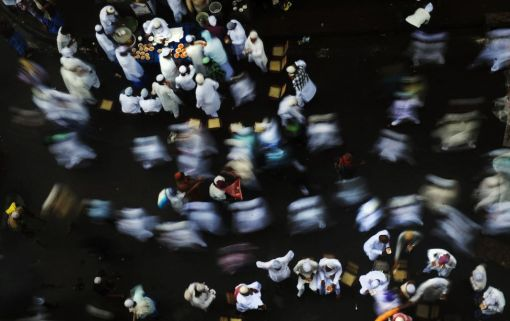 Indian Muslims stop to enjoy traditional sweets after offering Eid al-Fitr prayers in Kolkata on August 20, 2012. (Dibyangshu Sarkar - AFP/Getty Images)