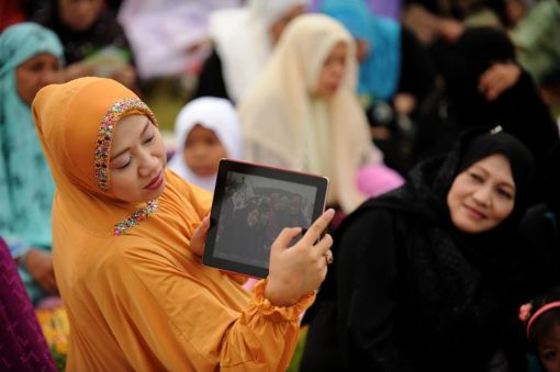 Filipino Muslim women gather to pray celebrating the start of Eid al-Fitr in Manila on August 19, 2012. (Noel Celis - AFP/Getty Images)