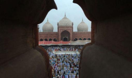 Pakistani Muslims offer Eid al-Fitr prayers at the Badshahi Masjid Mosque on August 20, 2012. (Arif Ali - AFP/Getty Images)