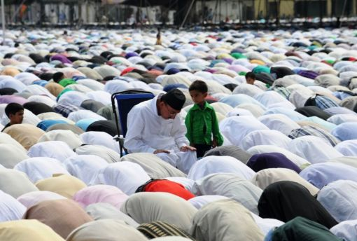 Kashmiri Muslims offer Eid al-Fitr prayers at Hazratbal shrine in Srinagar on August 20,2012. (Rouf Bhat - AFP/Getty Images)