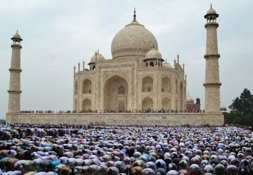 Indian Muslim devotees offer Eid al-Fitr prayers at the historic Taj Mahal in Agra on August 20, 2012. (Strdel - AFP/Getty Images)