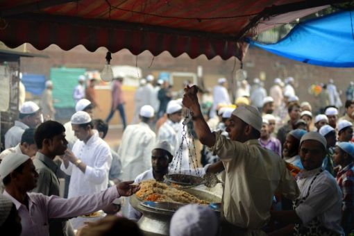 An Indian street vendor sells food to Muslim faithful after Eid al-Fitr prayers near the Jama Masjid Mosque in the old quarters of New Delhi on August 20, 2012. (Roberto Schmidt - AFP/Getty Images)