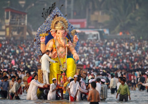 Devotees carry an idol of the Hindu elephant god Ganesh for immersion into the Arabian Sea on the last day of the Ganesh Chaturthi festival in Mumbai, September 29, 2012. Ganesh idols are taken through the streets in a procession accompanied by dancing and singing and later immersed in a river or the sea symbolising a ritual seeing-off of his journey towards his abode, taking away with him the misfortunes of all mankind. REUTERS/Vivek Prakash