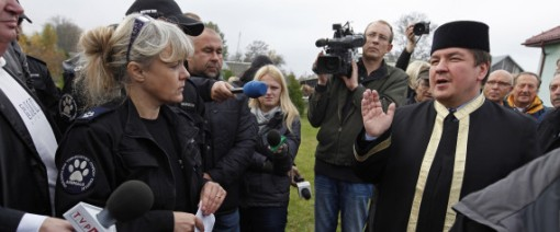 Mufti of Poland Tomasz Miskiewicz (R) speaks to animal rights activists and to reporters gathering outside the mosque in Bohoniki village, eastern Poland, on October 15, 2013. Photo by Getty Images.