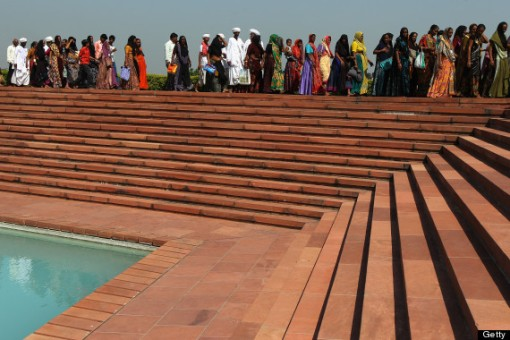 Tourists visit the The Baha'i House of Worship known as the 'Lotus Temple' ahead of the Delhi 2010 Commonwealth Games on September 30, 2010 in Delhi, India.