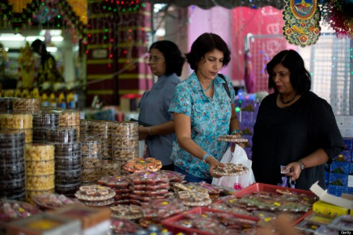 Indian women browse cookies ahead of the upcoming Diwali festival celebrations in the Brickfields area, also known as Little India, in Kuala Lumpur on October 21, 2013. Hindus throughout the world will celebrate Diwali on November 2. AFP PHOTO / MOHD RASFAN (Photo credit should read MOHD RASFAN/AFP/Getty Images)