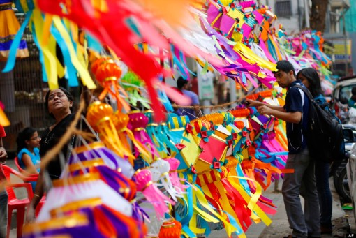 Indians buy lanterns from roadside stalls ahead of Diwali, the Hindu festival of lights, in Mumbai, India, Thursday, Oct. 31, 2013. Hindus light up their homes and pray to Lakshmi, the goddess of wealth, during the festival which will be celebrated on Nov. 3. (AP Photo/Rafiq Maqbool)