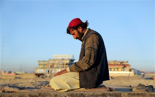 An Afghan man prays at the end of the day in Ghazni, Afghanistan Photo: AFP