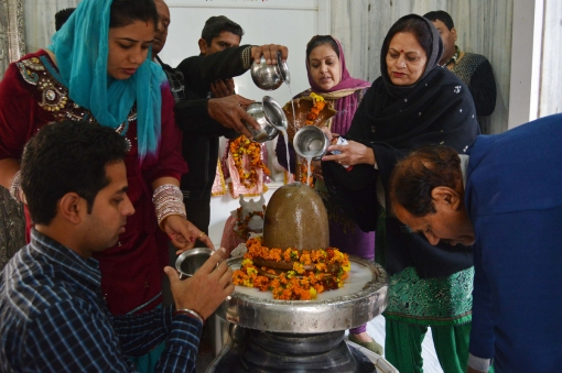 Indian Hindu devotees pour milk over a Lingam representing Lord Shiva at a temple on the eve of the Maha Shivratri festival in Amritsar on February 26, 2014. (NARINDER NANU/AFP/Getty Images)