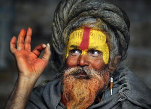 A Hindu Sadhu (holy man) poses for a photograph during the Maha Shivaratri festival at the Pashupatinath temple in Kathmandu on February 27, 2014. (PRAKASH MATHEMA/AFP/Getty Images)