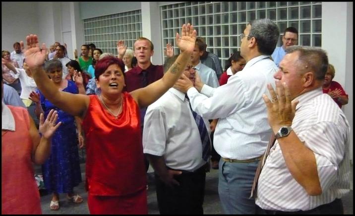 Parishioners of Church of God United Pentecostal Church during prayer