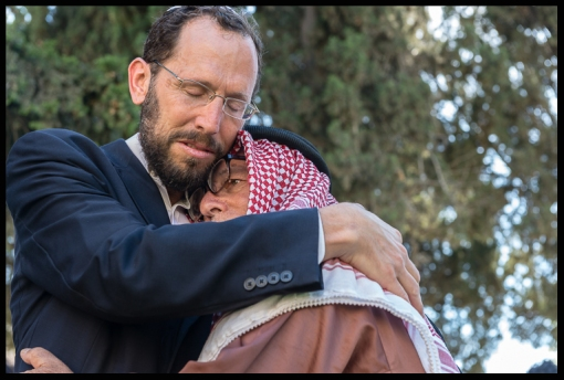 "Rabbi Dr. Yakov Nagen and Sheik Ibrahim Abu-el Hawa at peace manifestation called ""Jerusalem Hug"", June 2013."