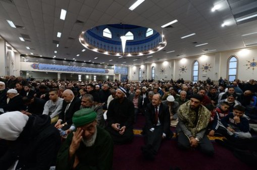 Muslims listen Eid al-Fitr sermons at the Lakemba Mosque in western Sydney on July 28, 2014. Thousands of Australian Muslims celebrated their religious Eid al-Fitr festival at the end of Ramadan. AFP PHOTO / Saeed Khan (Photo credit should read SAEED KHAN/AFP/Getty Images)