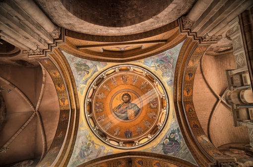 """The inner dome of the Greek Orthodox Catholicon inside the Church of the Holy Sepulchre, directly above """"the omphalos"""", once believed by Christians to mark the navel of the world"""