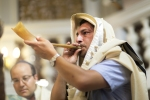 "A Tokea (which literally means ""blaster"") blows into a shofar in the Conegliano Synagogue in Jerusalem to announce the Jewish New Year, Rosh HaShanah (meaning ""head of the year"" in Hebrew)"