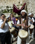 Musicians lead a Bar Mitzvah boy towards the Western Wall