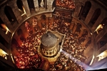The Ceremony of the Holy Fire takes place every year on the Saturday before Easter in the Church of the Holy Sepulchre. Meant to symbolize the resurrection of Jesus, it is considered by many Orthodox Christians to be the longest-attested annual miracle in the Christian world.  This extraordinary image was shot from high up in the rotunda of the Church of Holy Sepulchre during the Ceremony of the Holy Fire. Thousands of candles are lit off a single flame that emerges from the Edicule. Within minutes the entire dome is filled with smoke.