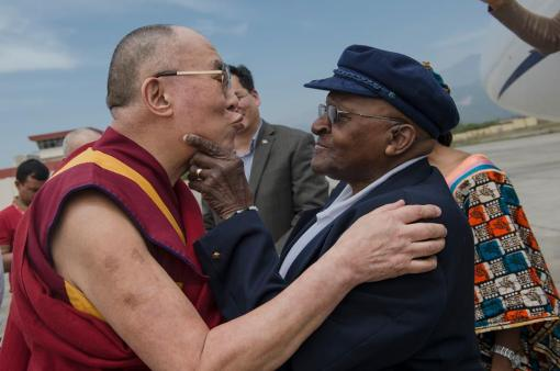 His Holiness the Dalai Lama and Archbishop Desmond Tutu exchange greetings on the Archbishop's arrival at Kangara Airport at the start of a seven day visit to collaborate on a book on joy in Dharamsala, India on April 18, 2015.